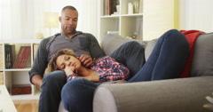 Girlfriend lying on boyfriend's lap Stock Footage