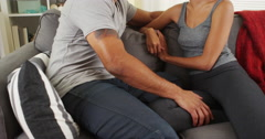 Affectionate black couple talking on couch Stock Footage