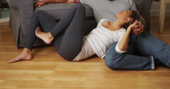 Sweet black couple talking on floor Stock Footage