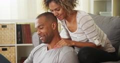 Black girlfriend giving boyfriend neck massage Stock Footage
