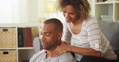 Black girlfriend giving boyfriend massage Stock Footage