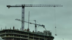 Construction Site Crane Lifting A Load - stock footage