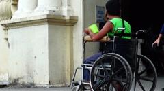 Paraplegic Beggar on Wheelchair Stock Footage