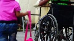 Wheelchair laden with beggar Stock Footage