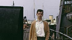 Southend early 1960s: young man walking on pleasure pier Stock Footage