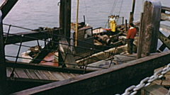 Southend early 1960s: seamen working on a ship - stock footage