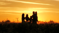 Sunset Caucasian Family Team Sibling Sisters Parents Affection Freedom Outdoor - stock footage