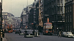London 1960s: traffic in Oxford street at Christmas time Stock Footage