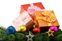 Stock Photo of colorful gift boxes and christmas tree isolated on white