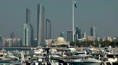 The United Arab Emirates city of Abu Dhabi 047 futuristic skyscraper and marina Stock Footage