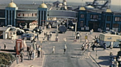 Clacton-on-Sea early 1960s: people in front of the Pier Stock Footage