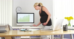 Pregnant businesswoman working in the office Stock Footage