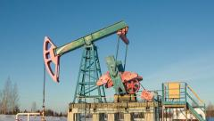 Worn oil pump (pumpjack) in Russia Stock Footage