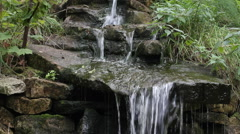 Pure fresh water waterfall and large stones in nature. Stock Footage