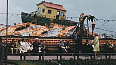Great Yarmouth early 1960s: people at Joyland theme park Stock Footage