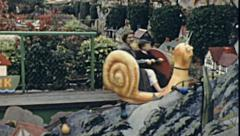 Great Yarmouth early 1960s: children at Joyland theme park Stock Footage
