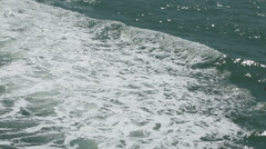Foamy waves created by a ferry in the sea Stock Footage