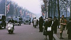London 1960s: people waiting for the Queen during a state visit Stock Footage