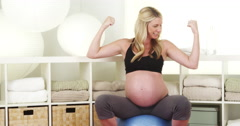 Happy pregnant woman sitting on exercise ball Stock Footage