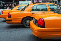 NEW YORK - JUN 11: Yellow cab speeds through Times Square the bu Stock Photos