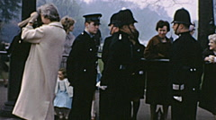 London 1960s: people and policemen after a state visit Stock Footage
