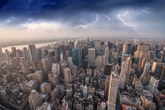 Manhattan skyline during a storm and Lightning, New York - stock photo