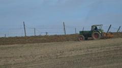 Slow Motion Farmer seedling on fresh earth in empty field Stock Footage