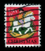 Child on rocking horse. christmas postage stamp Stock Photos