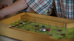 Elder pinball toy in action  - stock footage
