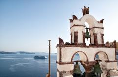 Vintage belfry in oia, santorini, greece Stock Photos