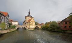 obere bridge (brücke) and altes rathaus and cloudy sky in bamberg - stock photo