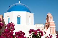 Iconic blue domed church in fira, santorini, greece Stock Photos