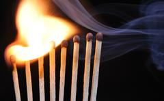 Concept with matches- chain reaction Stock Photos