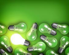 Idea concept with row of light bulbs and glowing bulb Stock Photos
