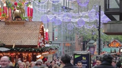 High Street Twinkling Xmas Lights Busy Shoppers at German Christmas Market Stock Footage