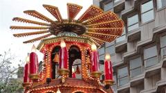 Spinning Santa, Xmas Lights Tilt - People Enjoying German Christmas Market Stall Stock Footage
