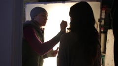 The actress doing the makeup on the set. Film shooting Stock Footage