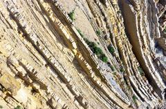Cliff of sedimentary rocks Stock Photos
