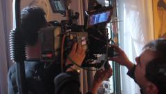 The cameraman and focus puller at work. Film shooting Stock Footage