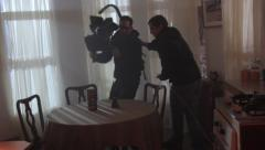 The cameraman and focuspuller work on shooting the film. Film shooting Stock Footage