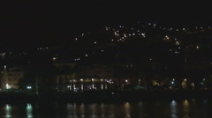 Pan left panoramic view San Remo resort night Sanremo cityscape crowded city sky Stock Footage