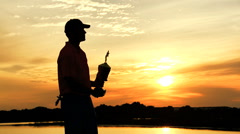 Silhouette Outdoor Winning Tour Lifestyle Golf Playing Male Caucasian Sunset Stock Footage