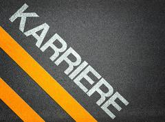 german karriere careers text writing road asphalt - stock illustration