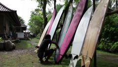 Waxing Surf Boards, 4 clips Stock Footage