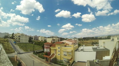 Time lapse blue sky with clouds from roof Stock Footage