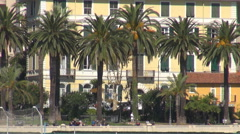 Closeup traffic street sea front street car pas San Remo resort Sanremo sunny Stock Footage
