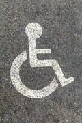 Disabled parking permit sign on the street Stock Photos