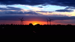 Windturbines by sunset skyline Holland highway Stock Footage