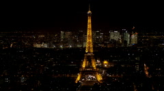 Aerial view of the eiffel tower and la defense at night Stock Footage