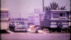 1358 - trailer park living next to freeway - vintage film home movie - stock footage